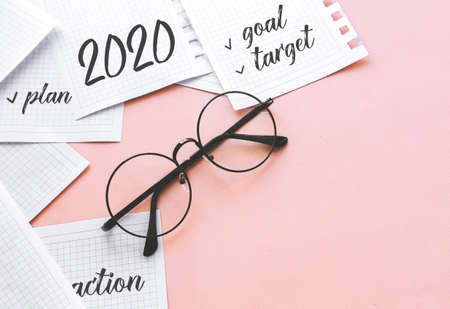 new goals for 2020. Composition flat lay. paper and glasses.