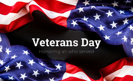 American flag on a black background. Veterans Day. honoring all who served. 11 november.