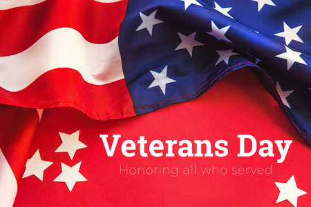 American flag on a red background. Veterans Day. honoring all who served. 11 november 版權商用圖片