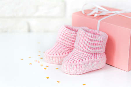 Waiting baby, baby shower. Pink girl newborn shoes. Stock fotó
