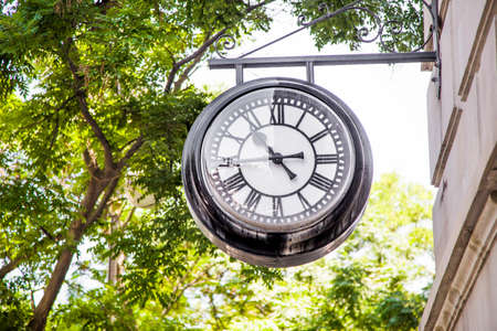 Vintage style street clock view close up.