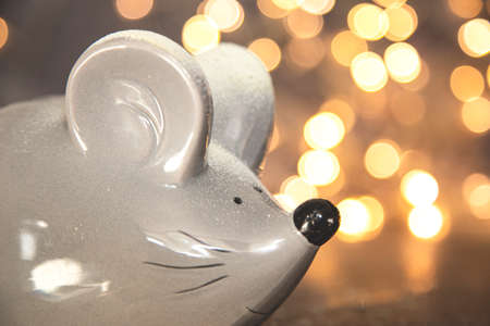 Symbol of Chinese New Year 2020 - Rat on a background of a burning garland.