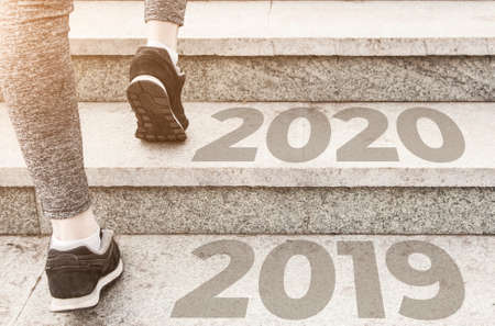 girl in sports uniform running around. Healthy way of life, an infused figure. sneakers close-up, finish 20189 Start to new year 2020, plans, goals, objectives. steps, stairs up.