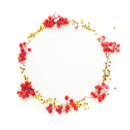 Round frame. Flat lay composition. Christmas accessories and decorations on red background. top view, copy space.