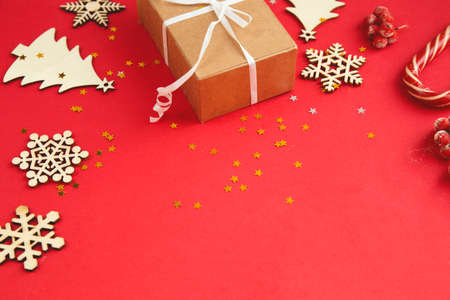 Flat lay composition. Christmas accessories and decorations on red background. top view, copy space.