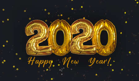 Gold Foil Balloons 2020 on black background. Happy New Years concept.
