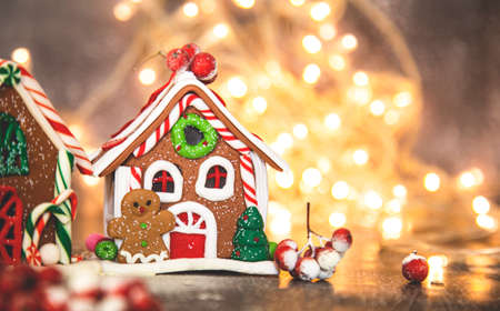 gingerbread, Christmas gingerbread house on the background of a New Years garland.
