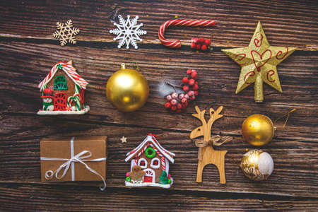 Flat lay composition. Christmas accessories and decorations on wood 写真素材