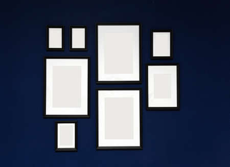 Composition of 8 black photo frames on a blue wall Zdjęcie Seryjne - 134165028