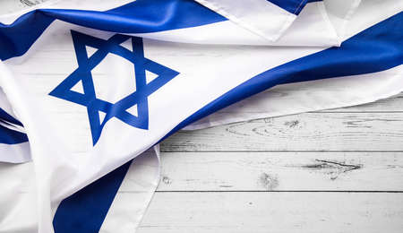 Close up shot of wavy blue and white Israeli flag. Happy independence day Israel, top view, flat lay.