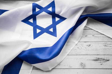 Close up shot of wavy blue and white Israeli flag
