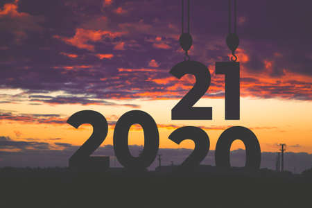 Sunset of 2020 year. digits 2021 against the sky. Goals, plans and tasks for the new year.