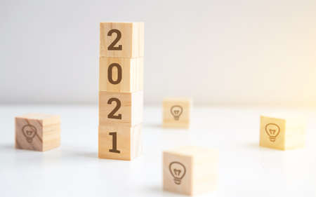 wooden cubes 2021 on a white background. plans, goals and actions for New Year Reklamní fotografie