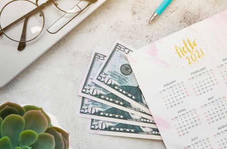 Office desktop top view. Notepad and Christmas decorations. Planing Calendar 2021. Budget 2021 Reklamní fotografie