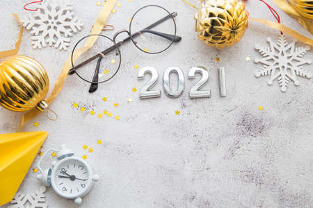 Office desktop top view. Notepad and Christmas decorations. Planing Calendar 2021