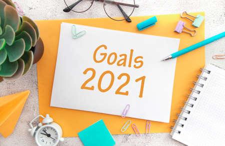 Office desktop top view. Notepad and Christmas decorations. Goals Calendar 2021