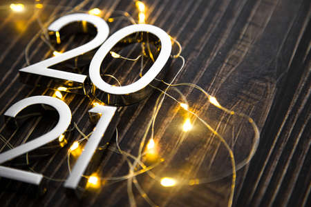 metal figures 2021 with a garland on a ninth background. new years eve.