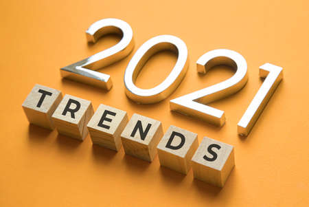 Wooden blocks with the word Trends and metal numbers 2021. Popular , relevant topics. New trends of fashion.