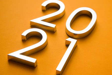 Close-up of metal numbers 2021 on orange background Reklamní fotografie