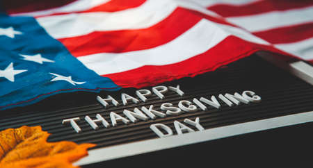 FLatlay composition happy thanksgiving day . american flag, pumpkins and autumn leaves on a black background. Reklamní fotografie