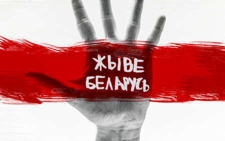 "hand and Belarusian flag. protests in Belarus after the presidential elections. The inscription on the photo in Belarusian ""lives in Belarus"""