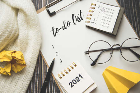 top view, goals and plans for the new year 2021, to-do list in notebook.