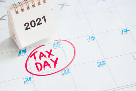concept for Tax day or april 15 , 2021 the national deadline for filing taxes. inscription on the calendar board