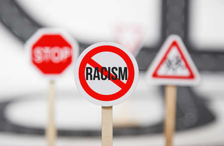 red stop sign. no racism, stop discrimination based on race religion gender . Promotion of equal rights and equal opportunities