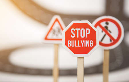 stop bullying sign. stop bullying. top discrimination based on race religion gender Фото со стока