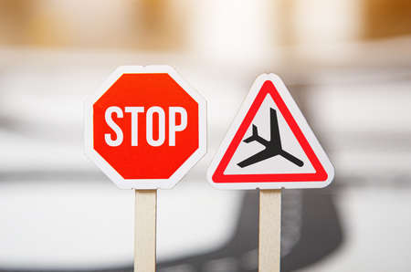 road sign - caution low-flying aircraft. Stopping flights during the coronavirus pandemic Фото со стока