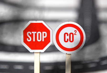 Sign with STOP CO2. the problem of environmental pollution, carbon emissions from cars and factories. carbon footprint Фото со стока