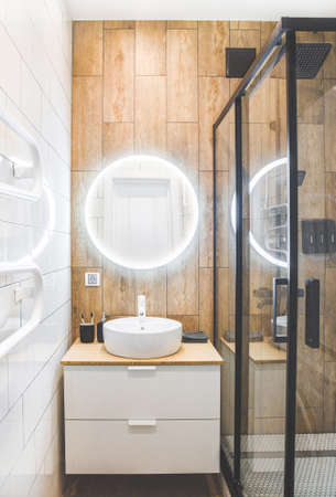 small bathroom with shower and washing machine. Interior Design Фото со стока