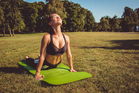 girl doing yoga and sports. on a natural background