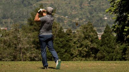 A man swinging a golf club