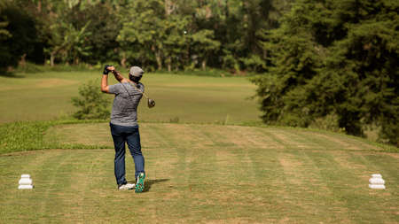 Professional golfer makes a kick on the ball