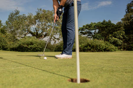 A person holding a golf club