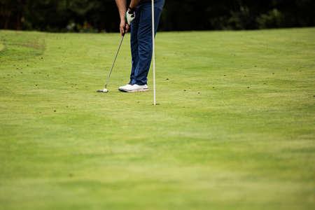 professional golfer on green grass