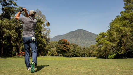 A person playing golf. Stock Photo