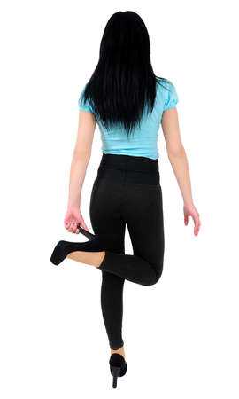 Isolated young casual woman back view photo