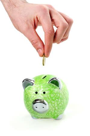 in insert: Insert coin in green piggy bank Stock Photo