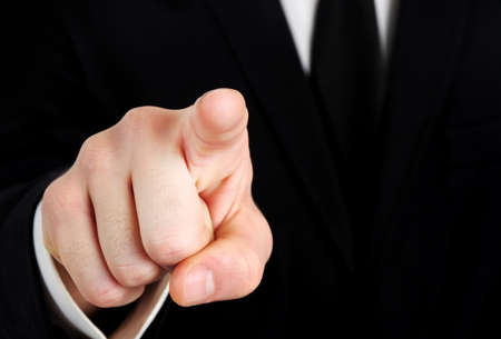 Business man hand pointing camera photo