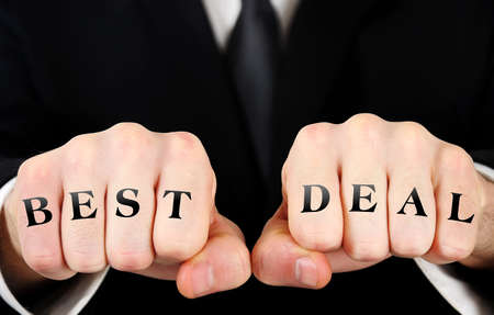 Businessman showing best deal word on fist photo