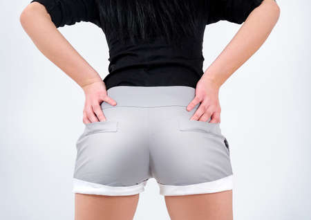 ass standing: Woman in shorts back view