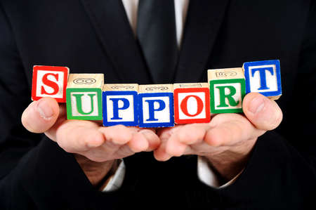 Business man showing word support Stock Photo - 19152352