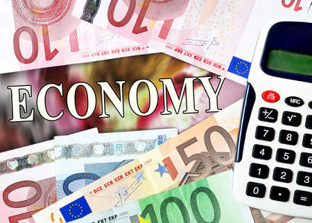 Economy word with money background photo