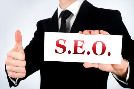 Business man showing SEO word Stock Photo - 19152325