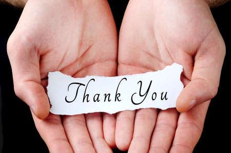 te negro: Man holding gracias palabra en la palma Foto de archivo