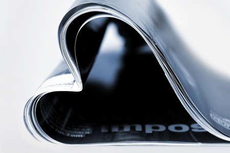 Magazine in heart shape on black Stock Photo - 19708216