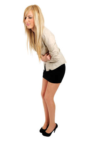 Isolated young business woman stomach pain photo