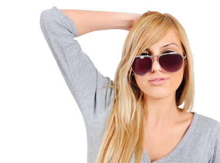 Isolated young casual girl with sunglasses photo